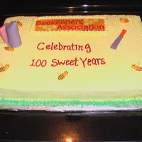 State Bee Club's 100Th Anniversary Chocolate cake with faux fondant icing. Bees, hive tool and smoker make from fondant.