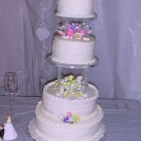 Rosch_Wedding.jpg White cake on top & bottom Chocolate cake in middle. Gumpaste roses