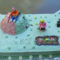 Brad's 50Th Cake for a carpenter who turned 50. Tools & figures made of fondant. Flowers are royal icing. Dirt was made of graham crackers with...