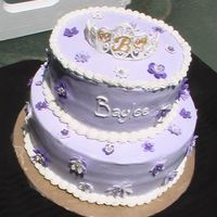 Baby Shower Cake Stacked cake with lavendar icing. Flowers are made from fondant and tiara made from royal icing. Cake was white and chocolate.