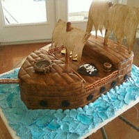 Pirate Ship Another last minute, rush. Chocolate cake, cookies n cream filling. Fondant covered, scored and painted with diluted brown coloring for...