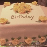Yellow Roses white fondant with yellow roses made of gumpaste, some royal icing ones, and some bc ones. i was trying out different techniques.
