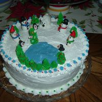 Winter Wonderland Strawberry cake with buttercream frosting and fondant figures.