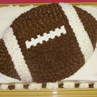Tevin's Birthday white cake, all buttercream icing, oblong cake pan, cut out the shape of a football. my son wanted a football and baseball for his birthday...