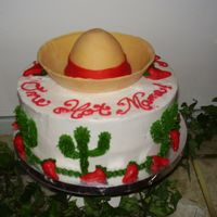 One Hot Mama   This was for a Surprise Mexican themed party.The Sombraro is made out of fondant.