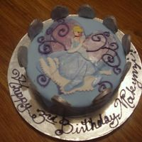 Cinderella Birthday Cinderella Cake covered in fondant with a fondant crown around the outside.