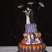 Fall Formal Cake 3 Tiers carved and covered in Fondant.The topper is made of gum paste and painted