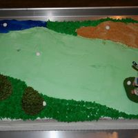 Golf Cake  On this cake I used a lil golf figure that I found at the local dollar store and then just used a sheet cake. I iced the green, then used...