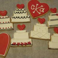 Wedding Cookies These are cookies that I did for a wedding. Colors were red, black and white. Sugar cookies with Antonia's icing.