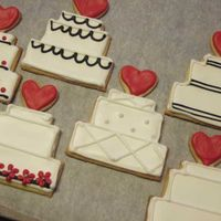 "Wedding Cakes Wedding cake cookies for a ""Valentines"" wedding. Colors were red, black and white. Sugar cookie with Antonia's icing"