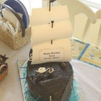 Pirate Ship White cake with MMF. Accents are all MMF. Sails are paper.