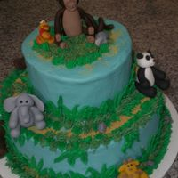 Jungle Cake this was for a baby shower, the cake is iced and decorated in buttercream the animals are made of fondant.