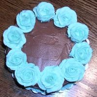 Tiffany Blue Roses The color is a little off in this photo, but it shows the top of the cake with all the roses. Some are better than others! I feel like...
