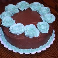 Tiffany Blue And Chocolate Brown Tiffany blue roses (Made with Crisco Butter Flavored icing and two drops Americolor Electric Blue) on chocolate real butter buttercream...