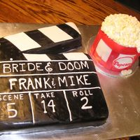 Clapboard And Bucket Of Popcorn My husband asked me to make these cakes for a movie premier. Thanks to all who helped me to envision and create these cakes. Both cakes are...