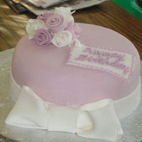 Almost A Bonnet Mauve and White Fondant over Buttercream. Ribbon Roses and Fondant Bow. This cake was made in a little over an hour and a half. This was my...