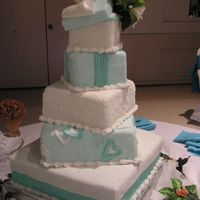 Tower Of Presents (Back) Tiffany Blue and white stacked square tiers. Covered in Fondant
