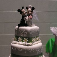 Mickey & Minnie Wedding Fondant Covered, mixed tier wedding cake with scroll work. Lime Green satinribbon, Fondant Daises and Mickey/Minnie Topper.