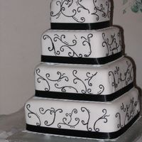 Simply Black & White 4 Tiered Wedding Cake. Stacked Construction. Buttercream covered in fondant with black scrollwork. I was petrified to decorate this cake...