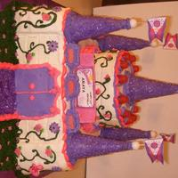 "3D Princess Castle 6"" cake for the castle tower, 10"" cake for the castle base, all done in BC icing. Sugar cones with purple icing rolled in purple..."