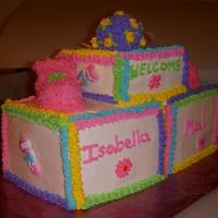"3D Baby Blocks These are 3- 3 layer 6"" square cakes al;l with BC icing. The rattle is made and shaped from truffle mix and a lollipop stick and..."