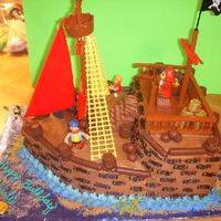 3D Pirate Cake This is a 1/2 sheet cake cut and shape to a pirate ship.....got a bonus on this cake, the client brought me the ENTIRE pirate ship kit so I...