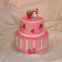 Strawberry Shortcake Frosted in buttercream with buttercream piping and fondant strawberries.