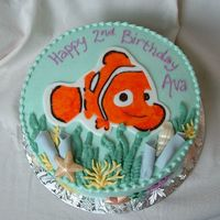 Nemo In The Ocean Iced in buttercream with fondant accents. Nemo is painted with food coloring on a fondant/gumpaste plaque. Seashells are white chocolate,...