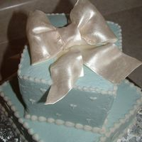 Another Package Cake Gumpaste bow, painted with luster dust. Buttercream icing.