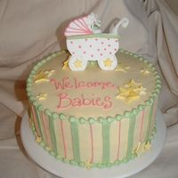 Baby Shower For 2 Buttercream frosting. Baby carriage and stars are a combination of gumpaste and fondant pieces.