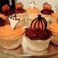 Halloween Cupcakes Fun little cupcakes with handmade chocolate ghosts and pumpkins as toppers.