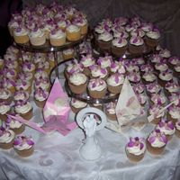 Orchid Wedding Cupcakes My first wedding cake order! 12 dozen orchid cupcakes for an Asian-themed table display.