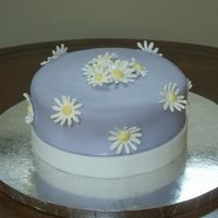 Daisey's My first MMF cake!! Cake is WASC with Chocolate Hazelnut BC. Covered in MMF with Royal Icing flowers