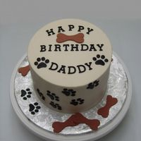 "Dog Paw Print Cake This was 2 6"" rounds stacked. Covered in buttercream, with fondant accents."