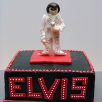 "Elvis This is an 8"" square cake with a 50/50 Elvis figure. ""Elvis"" is fondant with white bc dots. The black on the cake was..."