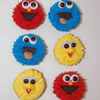 Baby Sesame Street Buttercream fur, and fondant eyes.