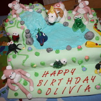 Jungle Waterfall Cake   A jungle cake for my daughter, added a few animals made from sugar paste including a unicorn (all the kids fav) and a penguin!