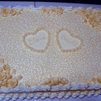 Simple Wedding/anniversary Cake Full sheet cake: Buttery cake with french vanilla filling and buttercream frosting.