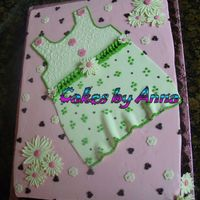 Baby Shower Cake 4 Girl 11x15 Chocolate Cake, Strawberry filling, Strawberry-buttercream frosting. Chocolate border, Gumpaste Daisys.