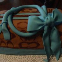 Coach Purse For My Sis chocolate cake with chocolate ganache and fondant. Fondant sliping due to ganache melting.