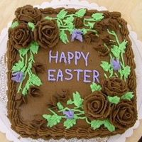Chocolate_Easter.jpg This is a yellow cake with chocolate frosting and flowers.