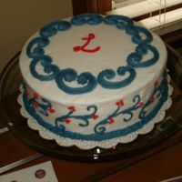 """l"" Cake This is a cake I made for my sister's wedding shower. The L on the cake is for her first name. I used a pattern press for the..."