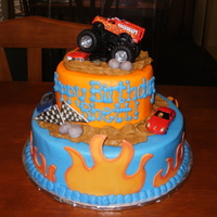 "Monster Truck Cake This is a 10"" dark chocolate fudge cake and 6"" strawberry cake iced in buttercream. Flames, flags, and rocks are fondant. Truck..."