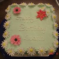 Birthday Cake For Girl Who's Nicname Is Daisy I made this for a friends sisters birthday. She loves Daisies, hates poinsettas, that is why there is a poinsetta on the cake. I think she...