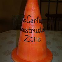 "Baby Under Construction Baby shower had a construction theme so the client wanted the cake to look like a construction cone. Built the cake with 2, 8"" rounds..."