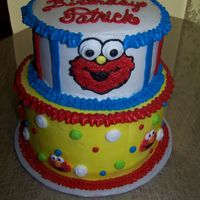 Patrick's Elmo Cake 8 and 6 inch rounds. Patrick loves Elmo so that is what he got!White cake with strawberry and marble cake with chocolate creme! Sesame...