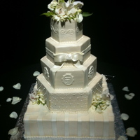 Buttercream Wedding Cake With Fondant Accents.