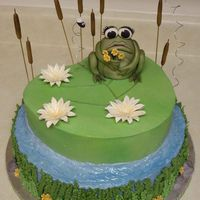Frog N Flowers Made for a friends B-Day. Two layer, BC with MMF accents, water has piping gel for added shine, cattails are spaghetti with MMF, the frog...