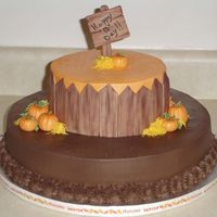 Fall Birthday 16 inch spice cake w/ milk chocolate frosting. Second layer 10 inch lemon cream cake w/ bc frostong. MMF fence, pumpkins and sign.