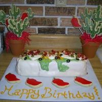 Burrito I made this 'burrito' cake for a Cinco de Mayo birthday party alongwith 2 chili pepper/cactus cookie bouquets. Its a margarita...